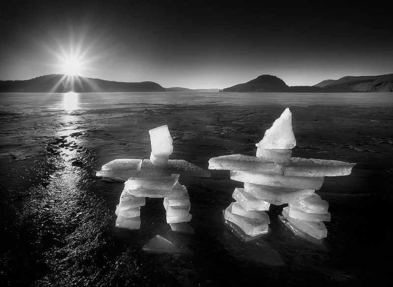 An early morning collecting ice chunks from the river and creating these inukshuks before sunrise. I had frozen hands for the...