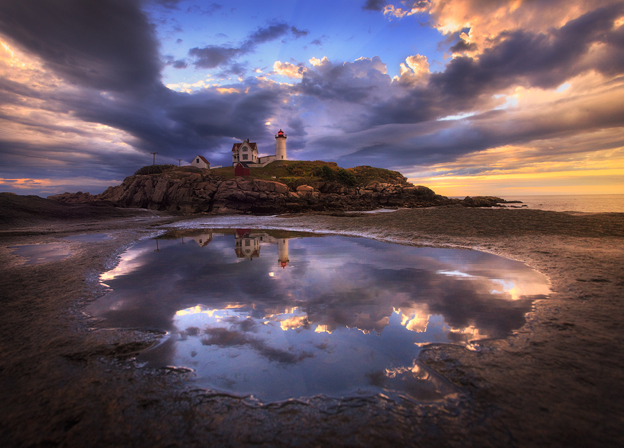 This was my first sunrise at Nubble Lighthouse a few years ago and it was a special lightshow! After a little searching I found...