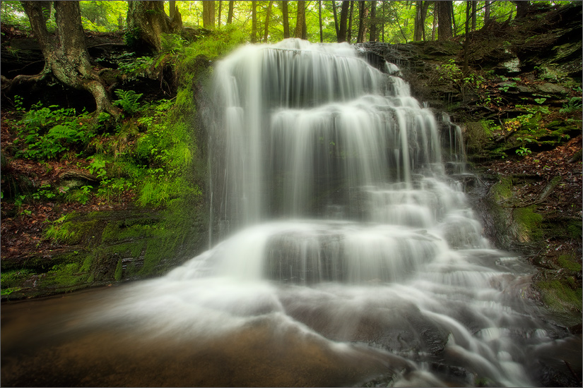 A waterfall I have been to many times. I'm always amazed at how water level, environmental conditions and light can present completely...